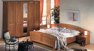 Ložnice ANGELA společnosti Mireal v provedení masivní dub. U dvojlůžka lze volit šířky 160, 180 i 200 cm a délky 200, 210 a 220 cm.