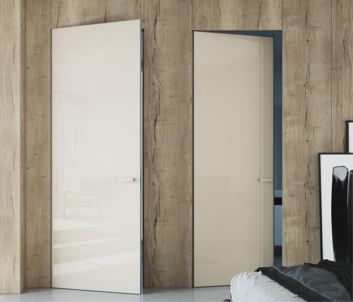 Dveře zabudované ve skryté zárubni tvoří se stěnou hladkou plochu